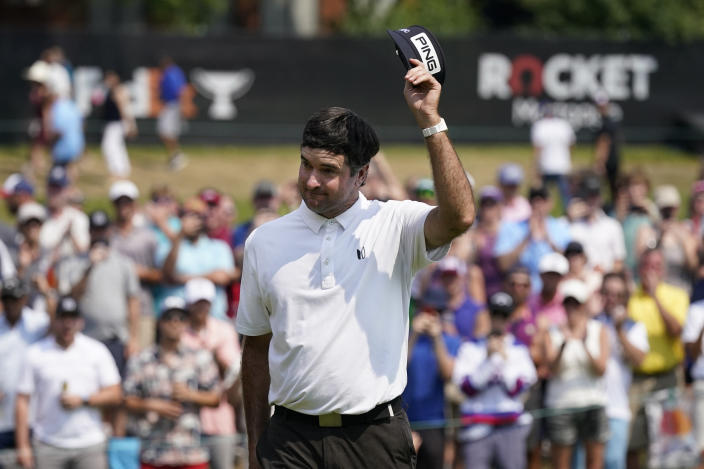 Bubba Watson acknowledges the crowd after his birdie putt on the 18th green during the final round of the Rocket Mortgage Classic golf tournament, Sunday, July 4, 2021, at the Detroit Golf Club in Detroit. (AP Photo/Carlos Osorio)