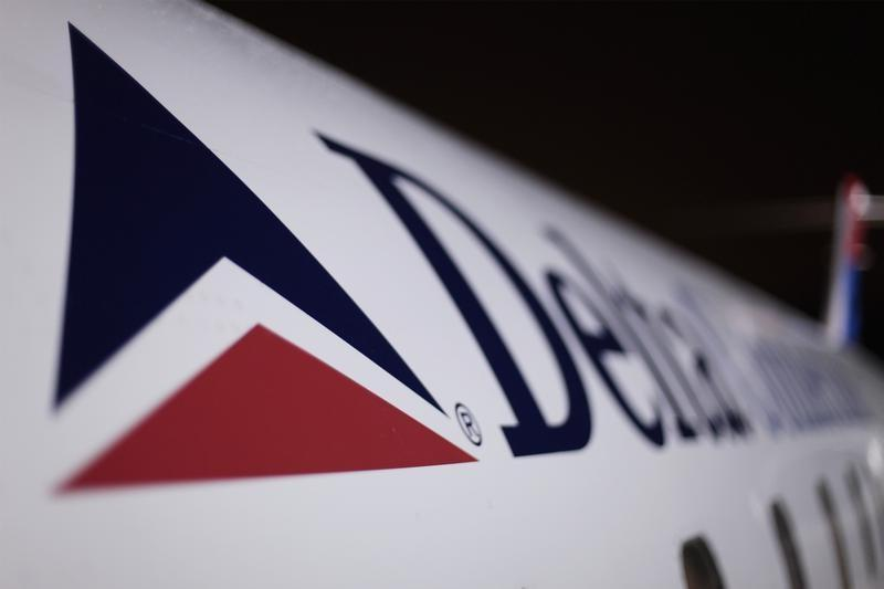 A Delta plane sits on a runway prior to takeoff at John F Kennedy International Airport in New York