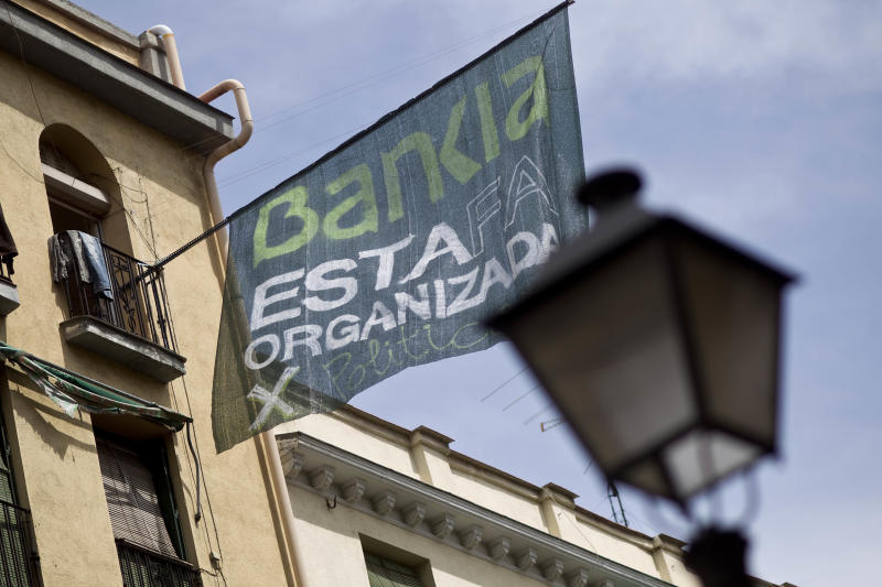 News Summary: Spain pressed to outline bank plan