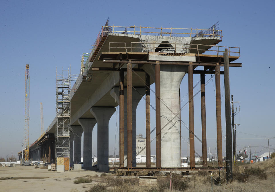 FILE — In this Dec. 6, 2017 file photo, one of the elevated sections of the high-speed rail is under construction in Fresno, Calif. Lawmakers and the Newsom administration are still trying to reach agreement on whether to give the project $4.2 billion that's left in the bond fund voters approved for high-speed rail in 2008. Rail officials say the need it to continue construction beyond next summer, but some state lawmakers want more oversight of the project before releasing it. (AP Photo/Rich Pedroncelli, File)