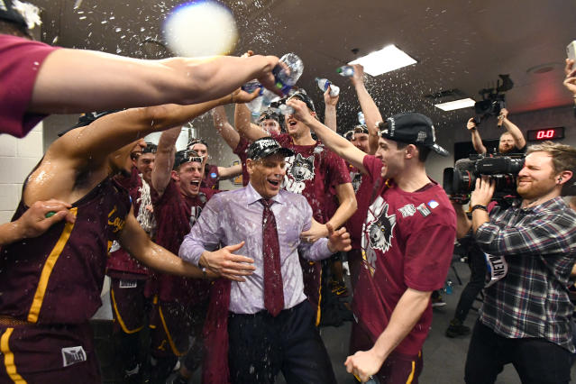 Loyola head coach Porter Moser gets doused by his players after the Ramblers beat Kansas State to advance to the Final Four. (Getty)
