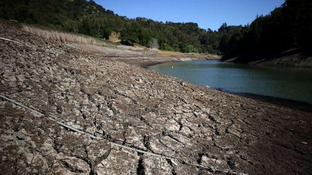 PHOTO: Dry cracked earth is visible along the banks of Phoenix Lake on April 21, 2021, in Ross, Calif. (Justin Sullivan/Getty Images)