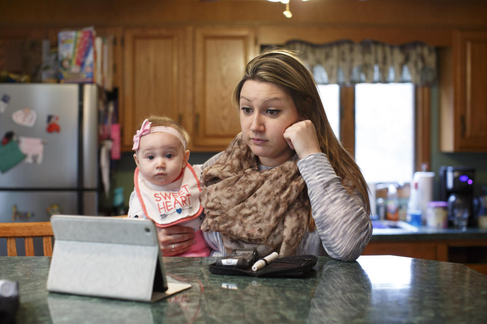 WILMINGTON, MA - MARCH 15: Erica Jensen, with her 5-month-old daughter, Charlee Jaques, by her side, video conferenced with her doctor, Dr. Marie McDonnell, from her mother's home in Wilmington, Mass. on Tuesday afternoon, March 15, 2016. (Photo by Dina Rudick/The Boston Globe via Getty Images)