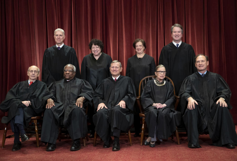 FILE - In this Nov. 30, 2018, file photo, the justices of the U.S. Supreme Court gather for a formal group portrait to include the new Associate Justice, top row, far right, at the Supreme Court building in Washington. Seated from left: Associate Justice Stephen Breyer, Associate Justice Clarence Thomas, Chief Justice of the United States John G. Roberts, Associate Justice Ruth Bader Ginsburg and Associate Justice Samuel Alito Jr. Standing behind from left: Associate Justice Neil Gorsuch, Associate Justice Sonia Sotomayor, Associate Justice Elena Kagan and Associate Justice Brett M. Kavanaugh. It's the time of the year when Supreme Court justices can get testy, but they might have to find a new way to show it. (AP Photo/J. Scott Applewhite, File)