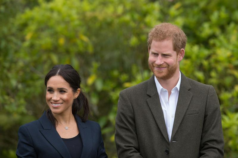 Meghan Markle in suit, Prince Harry in suit