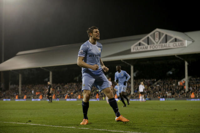 Manchester City's James Milner celebrates his goal during the English Premier League soccer match between Fulham and Manchester City at Craven Cottage stadium in London, Saturday, Dec. 21, 2013. (AP Photo/Matt Dunham)