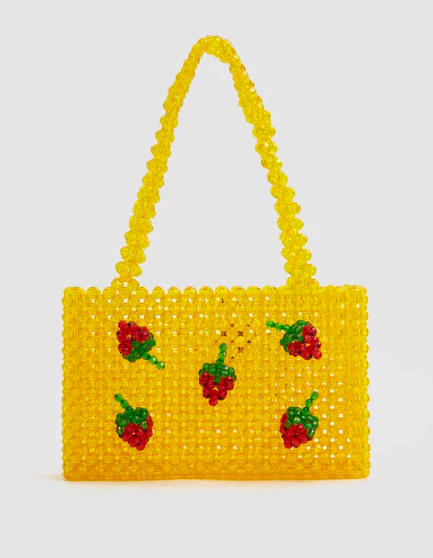 """Leave it to <a href=""""https://fave.co/32VMoM9"""" rel=""""nofollow"""" target=""""_blank"""">Susan Alexandra</a> to cure your Monday blues with her signature bright and beaded bags. If Candy Land were a fashion brand, this would be it. $295, Need Supply. <a href=""""https://needsupply.com/ichigo-mini-tote-bag/W104621.html?lang=en_US"""">Get it now!</a>"""