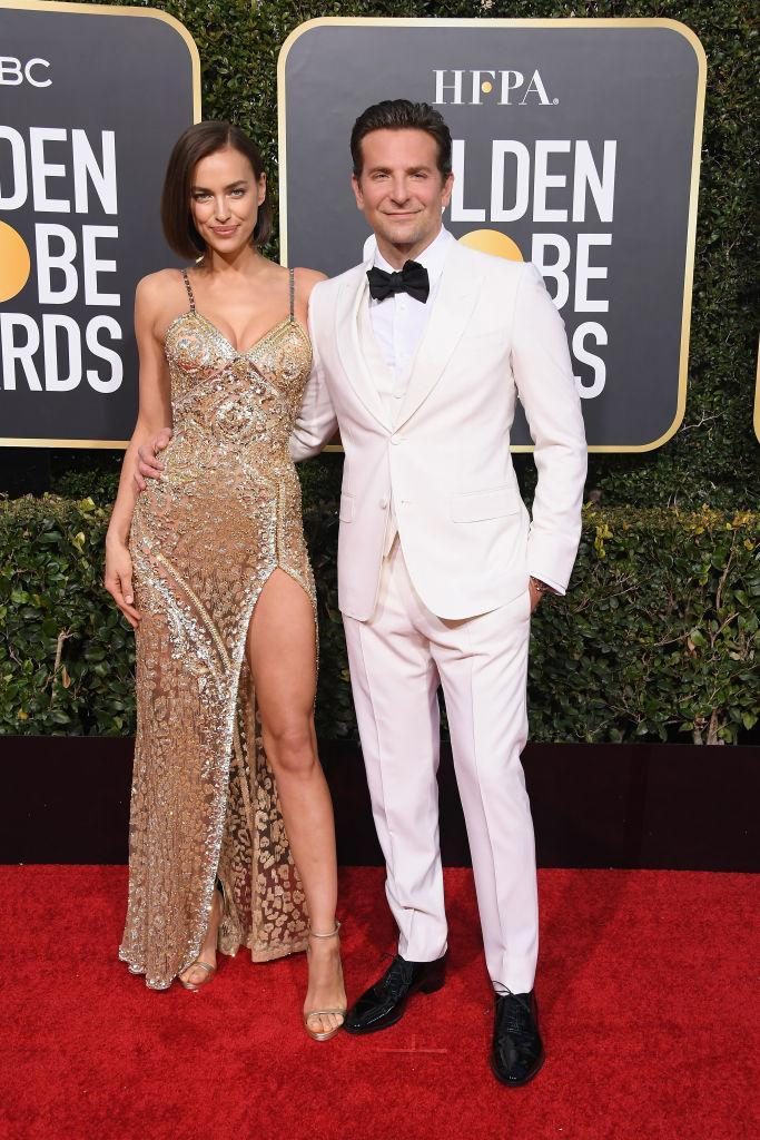 <p>The director and star of <i>A Star Is Born</i> had his model wife by his side at the 76th Annual Golden Globe Awards. Cooper, who chose a white suit for his big night, is nominated for his work both in front of and behind the camera on the film, and his movie is up for three more awards, including the big one for Best Drama. (Photo: Getty Images) </p>