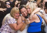 From left, Kathy Brown, of Paradise Valley, Virginia Aguiar, of Scottsdale, Jane Crook, of Scottsdale, react to a guilty verdict for Jodi Arias, Wednesday, May 8, 2013, outside of Maricopa County Superior Court in Phoenix. Arias was convicted of first-degree murder in the gruesome killing of her one-time boyfriend in Arizona after a four-month trial that captured headlines with lurid tales of sex, lies, religion and a salacious relationship that ended in a blood bath. (AP Photo/The Arizona Republic, David Wallace) MARICOPA COUNTY OUT; MAGS OUT; NO SALES