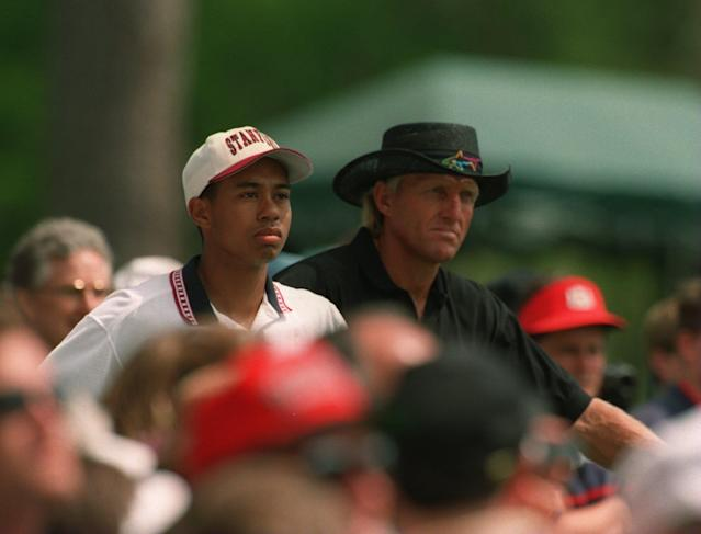 A very young Tiger Woods and Greg Norman in 1995. (Getty)