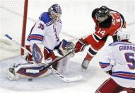 New York Rangers goalie Henrik Lundqvist, left, of Sweden stops a shot by New Jersey Devils center Adam Henrique as Rangers defenseman Dan Girardi skates in during the second period of Game 3 of an NHL hockey Stanley Cup Eastern Conference final playoff series, Saturday, May 19, 2012, in Newark, N.J. (AP Photo/Frank Franklin II)
