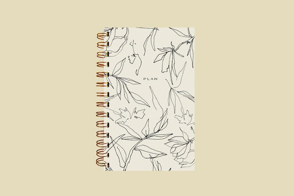 """<p>Besides a minimalist chic style, this planner adds on an area of self-care to the daily checklist, featuring to-do items like hydrate and move.</p> <p><strong><em>Shop Now:</em></strong><em> Wilde House Paper """"Flora"""" Weekly Planner, $28, <a href=""""https://shop-links.co/1712544860395028108"""" rel=""""nofollow noopener"""" target=""""_blank"""" data-ylk=""""slk:verishop.com"""" class=""""link rapid-noclick-resp"""">verishop.com</a>.</em></p>"""