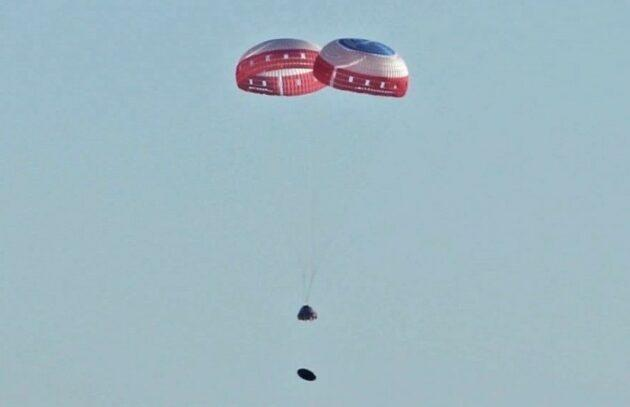 Boeing's CST-100 Starliner space taxi descends on the end of two parachutes during this week's pad abort test. The Starliner's heat shield can be seen falling away beneath the craft. (Boeing Photo)