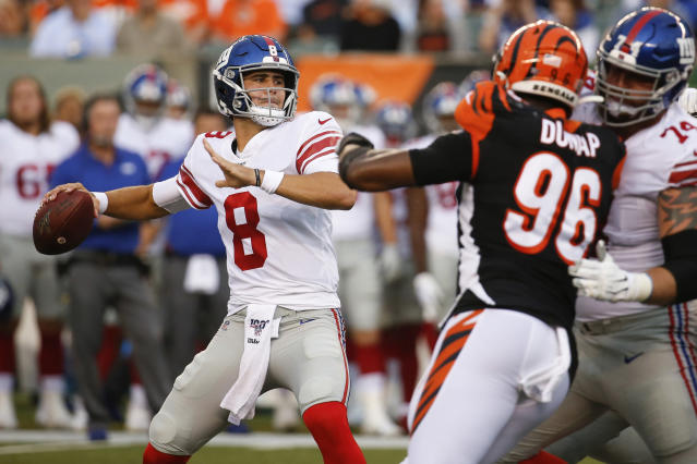 FILE - In this Aug. 22, 2019, file photo, New York Giants quarterback Daniel Jones (8) looks for a receiver during the first half of an NFL preseason football game against the Cincinnati Bengals in Cincinnati. Eli Manning's long and distinguished reign as the New York Giants' starting quarterback is seemingly over. Let the Daniel Jones era begin. Coach Pat Shurmur announced Tuesday, Sept. 17, 2019, that the No. 6 overall pick in the NFL draft is replacing two-time Super Bowl MVP as the Giants' quarterback, beginning Sunday at Tampa Bay.(AP Photo/Frank Victores, File)