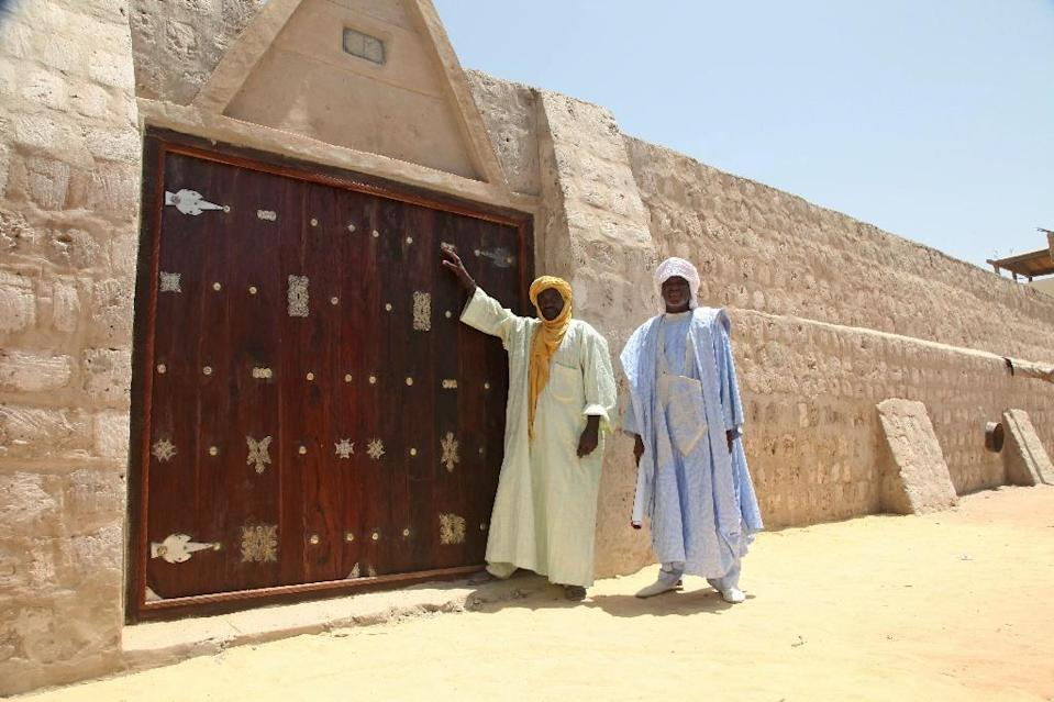 Jihadists destroyed the doors of a revered 15th-century mosque in Tumbuktu which has since been renovated (AFP Photo/SEBASTIEN RIEUSSEC)