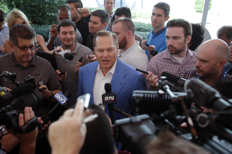 FILE - In this Nov. 15, 2017, file photo, Sports agent Scott Boras answers questions during a news conference at the annual MLB baseball general managers' meetings in Orlando, Fla. Nearly 30 years after negotiating his first contract, Boras worked out $814 million in deals for Stephen Strasburg, Gerrit Cole and Anthony Rendon in a three-day span, part of what is expected to be a $1.2 billion offseason for baseball's most visible agent. (AP Photo/John Raoux, File)