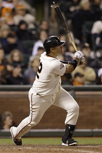San Francisco Giants' Guillermo Quiroz watches his game winning home run hit off Los Angeles Dodgers' Brandon League in the tenth inning of a baseball game Saturday, May 4, 2013, in San Francisco. (AP Photo/Ben Margot)