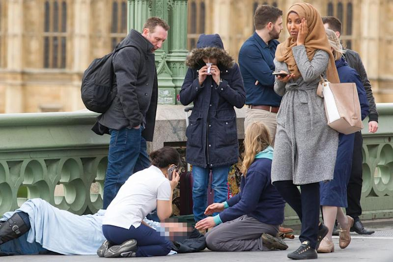 Medics and passers by treat a victim on Westminster Bridge (Jamie Lorriman)