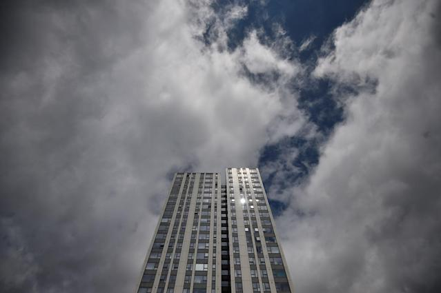 <p>The sun glints off a window in the Dorney Tower residential block, from where residents were evacuated as a precautionary measure following concerns over the type of cladding used on the outside of the buildings on the Chalcots Estate in north London, Britain, June 25, 2017. (Photo: Hannah McKay/Reuters) </p>