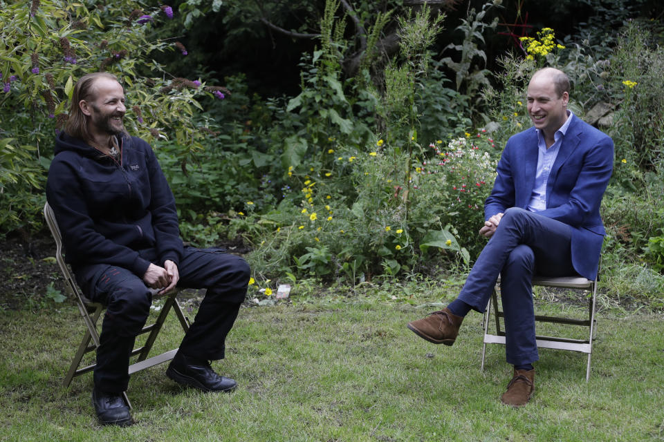 EMBARGOED TO 2200 SATURDAY JULY 18 The Duke of Cambridge speaks with service user Robert Farrand during a visit to the Garden House part of the Peterborough Light Project, a charity which offers advice and support to rough sleepers.