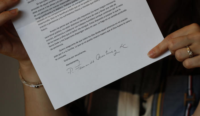 "In this Jan. 14, 2020 photo, Ana Lucia Salazar holds one of the letters that her abuser sent to her asking for forgiveness, during an interview in Mexico City. Her abuser begged her forgiveness ""for the grave harm I caused you."" He termed his behavior ""faults"" that were the result of an ""uncontrolled sexuality."" (AP Photo/Marco Ugarte)"