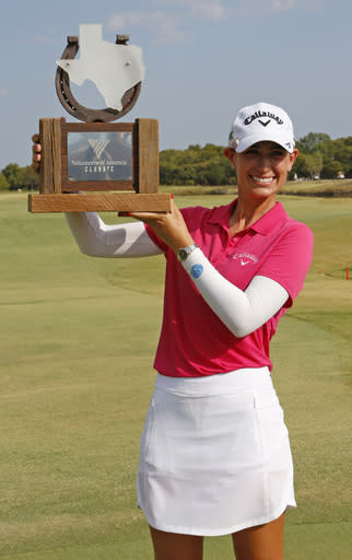 Cheyenne Knight, from Aledo, Texas, holds the trophy after winning the LPGA Volunteers of America golf tournament Sunday, Oct. 6, 2019, at Old American Golf Club in The Colony, Texas. (AP Photo/David Kent)