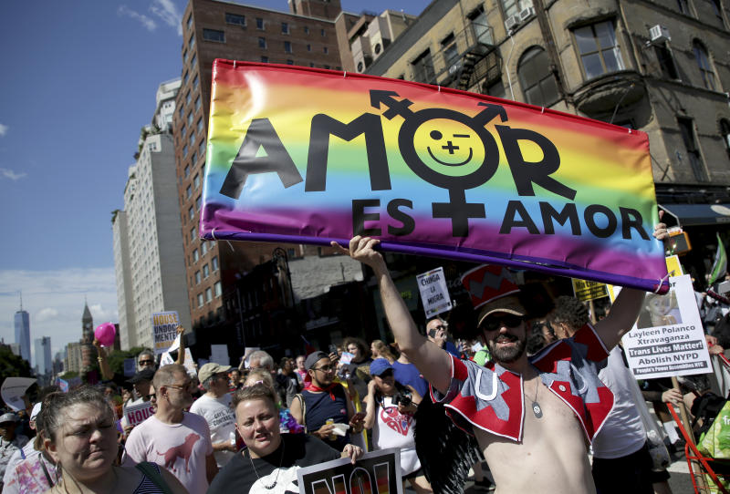 FILE - In this June 30, 2019, file photo, marchers participate in the Queer Liberation March in New York. This year's Pride events were supposed to be a blowout as LGBTQ people the world over marked the 50th anniversary of the first parade to celebrate what were then the initial small steps in their ability to live openly, and to advocate for bigger victories. Now, Pride is largely taking a backseat, having been driven to the internet by the coronavirus pandemic and now by calls for racial equality that were renewed by the killing of George Floyd in Minneapolis at the hands of police. (AP Photo/Seth Wenig, File)