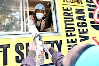 <p>Offset hands out hot meals during an Election Day Pop-Up event on Tuesday in Atlanta.</p>