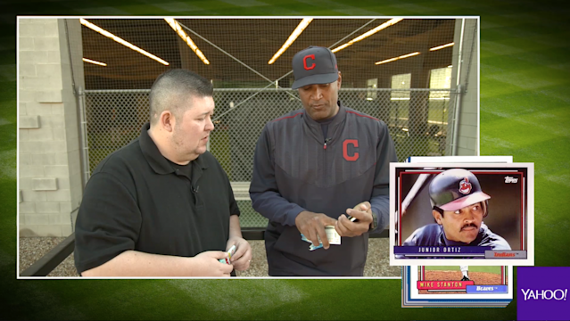 Sandy Alomar Jr. opening 25-year-old baseball cards. (Yahoo Sports)