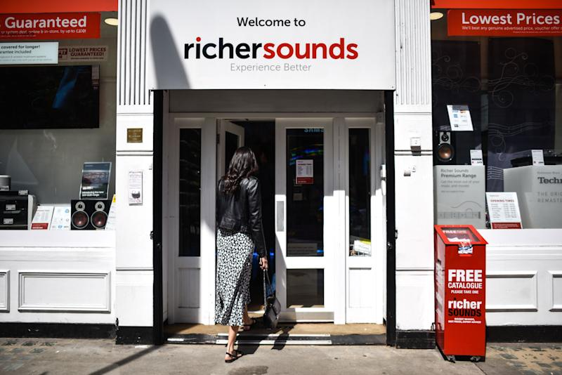 LONDON, ENGLAND - MAY 15: A woman enters a Richer Sounds branch on May 15, 2019 in London, England. Julian Richer, who founded the business in 1978, has announced he is handing over control of his business to employees in an employee-owned trust. More than 500 staff will also share a bonus of £3.5m as owner Julian Richer signs over 60 per cent of the company.(Photo by Peter Summers/Getty Images)