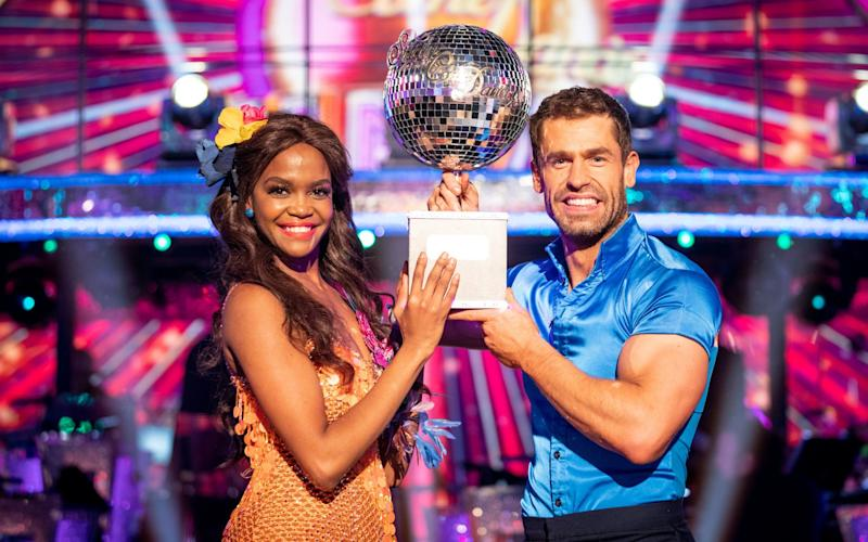 Oti and Kevin pose with the Glitterball trophy - PA