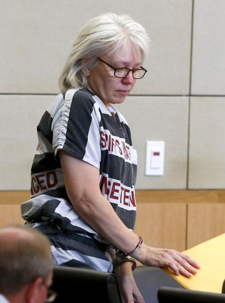 FILE - In this Aug. 1, 2013, file photo, Debra Jean Milke, convicted in the 1989 shooting death of her 4-year-old son for an insurance payout, arrives for a hearing at Maricopa County Superior Court in Phoenix. Milke, who has spent more than two decades on death row, is expected to be released on Friday, Sept. 6, 2013, while she awaits a retrial of her case. A judge set Milke's bond at $250,000 a day earlier, saying there's no direct evidence linking her to her son's death other than a purported confession to a detective. (AP Photo/Ross D. Franklin, Pool, File)