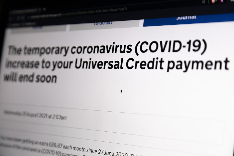 In this photo illustration, a laptop screen shows a notice to a benefits recipient that the temporary coronavirus (COVID-19) increase to their Universal Credit payment will be removed by the end of September on 5th September, 2021 in Leeds, United Kingdom. British Chancellor Rishi Sunak is set to remove the £20 a week uplift to Universal Credit recipients in a move that critics have said will force the country's poorest further into poverty. (photo by Daniel Harvey Gonzalez/In Pictures via Getty Images)
