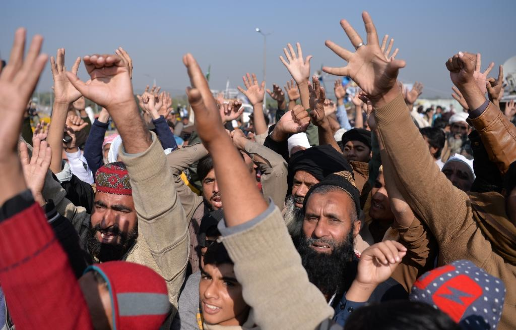 The roughly 2,000 protesters from the Tehreek-i-Labaik Ya Rasool Allah Pakistan group have blocked a main highway used by thousands of commuters since November 6, causing hours-long traffic snarls (AFP Photo/AAMIR QURESHI)