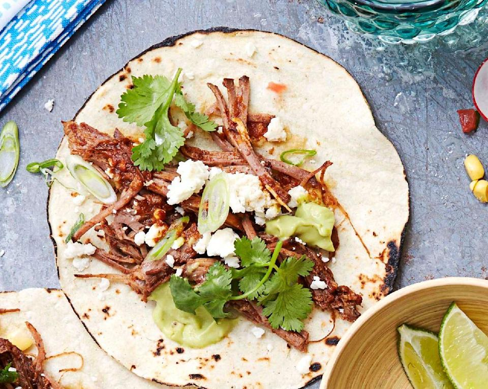 """<p>Thanks to the slow cooker, these tacos pretty much make themselves, so you can focus on getting game-day ready. </p><p><a href=""""https://www.goodhousekeeping.com/food-recipes/a32690/bbq-brisket-tacos/"""" rel=""""nofollow noopener"""" target=""""_blank"""" data-ylk=""""slk:Get the recipe for BBQ Brisket Tacos »"""" class=""""link rapid-noclick-resp""""><em>Get the recipe for BBQ Brisket Tacos »</em></a><br></p>"""