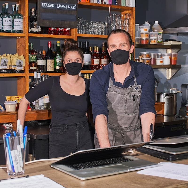 Owners Eden Rehmet and Jake Adams preparing to-go orders at their restaurant, Hollow in Delhi, NY