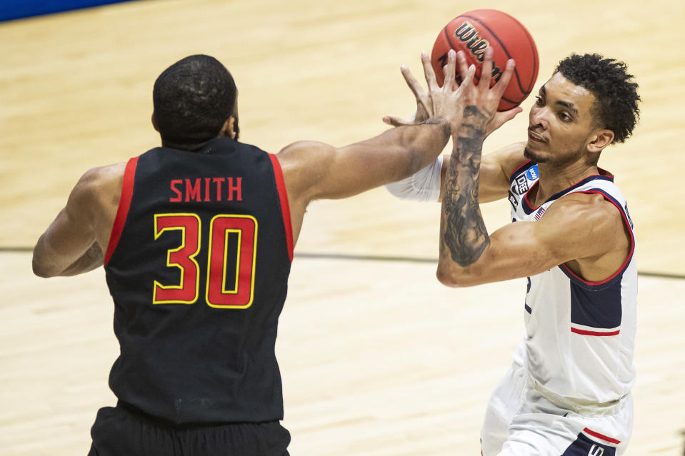 Connecticut's James Bouknight, right, is defended by Maryland's Galin Smith (30) during the first half of a first round game in the NCAA men's college basketball tournament, Saturday, March 20, 2021, at Mackey Arena in West Lafayette, Ind. (AP Photo/Robert Franklin)