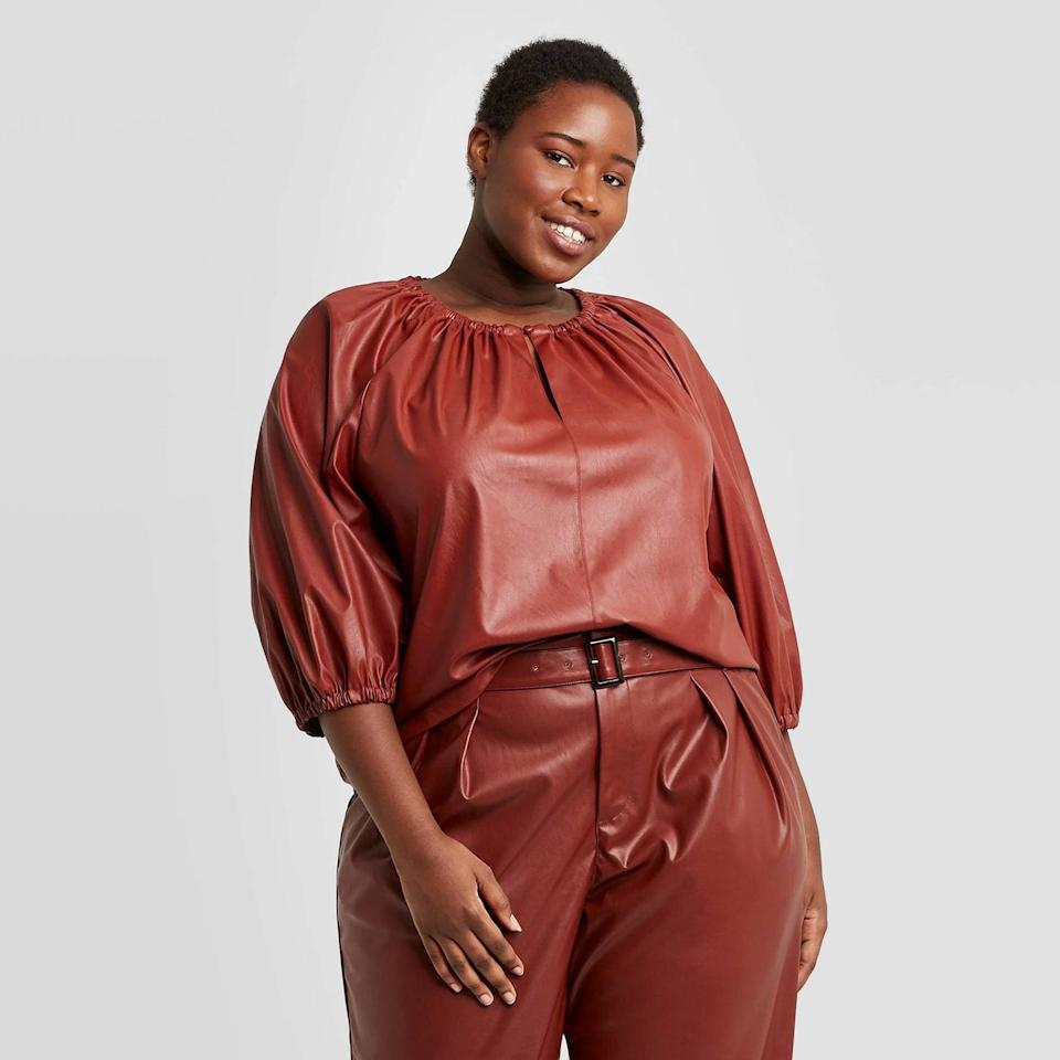 <p>Pair this <span>Faux Leather Balloon 3/4 Sleeve Blouse</span> ($33) with leather pants for an edgy look. </p>