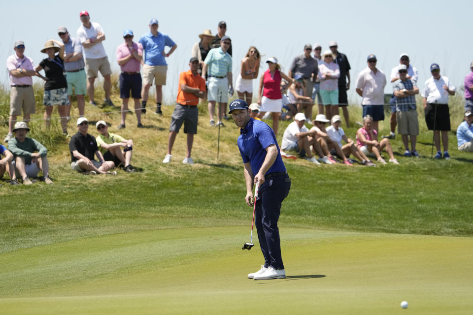 Branden Grace, of South Africa, watches his birdie on the 15th hole during the second round of the PGA Championship golf tournament on the Ocean Course Friday, May 21, 2021, in Kiawah Island, S.C. (AP Photo/David J. Phillip)