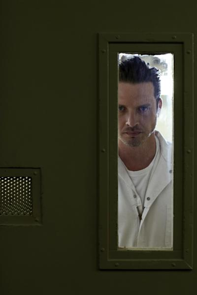 "This publicity image released by the Sundance Channel shows Aden Young in a scene from the drama series ""Rectify."" The six-hour miniseries, whose first two hours air on Sundance Channel on Monday at 9 p.m., tells a unique story about a man who was caged for two decades for the rape and murder of his teenage girlfriend. Then, when his conviction is vacated thanks to new DNA evidence, he is restored to an outside world that proves just as harrowing. (AP Photo/Sundance Channel)"