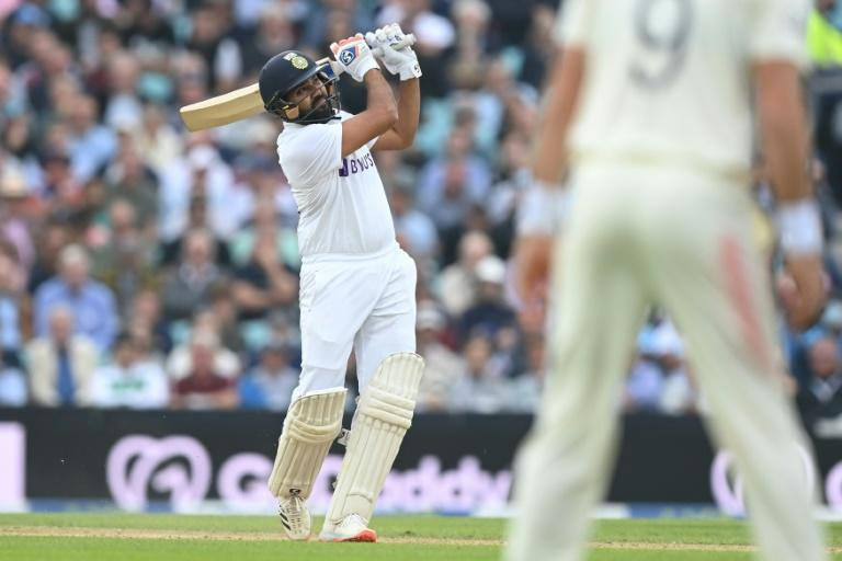 Joy of six: India's Rohit Sharma drives Moeen Ali high over long-on to go to a hundred in the fourth Test against England at the Oval (AFP/DANIEL LEAL-OLIVAS)
