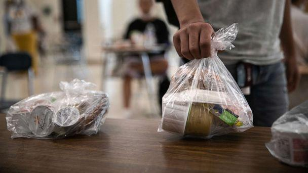 PHOTO: A student picks up a free individually bagged lunch in the cafeteria during the first day of school at Stamford High School on Sept. 08, 2020, in Stamford, Conn. (John Moore/Getty Images)