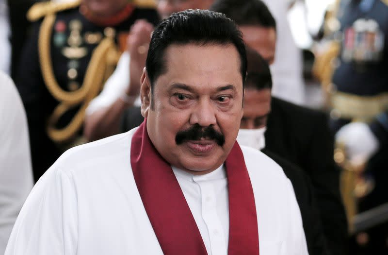 Sri Lanka's Prime Minister Mahinda Rajapaksa reacts during his swearing in ceremony as the new Prime Minister, at Kelaniya Buddhist temple in Colombo
