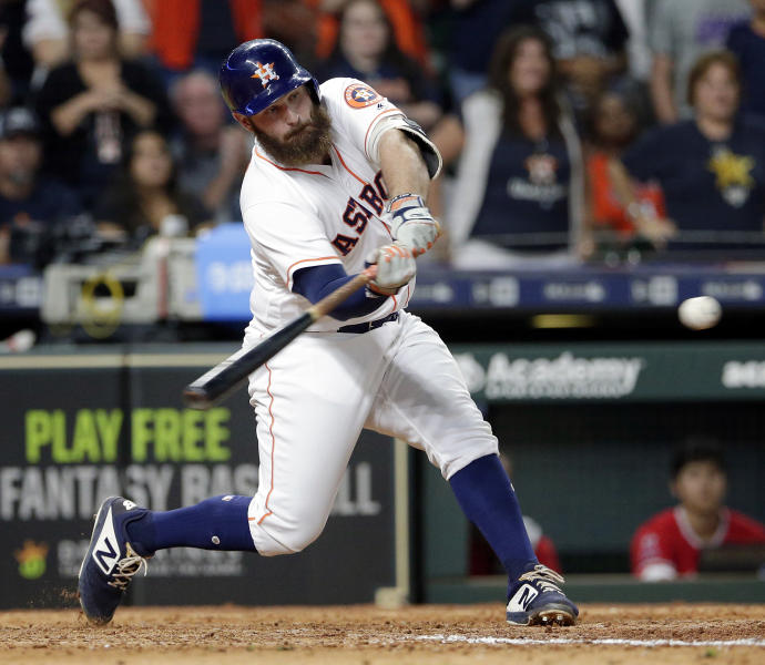 Houston Astros' pinch hitter Tyler White connects for a single, driving in two runs to put them ahead of the Los Angeles Angels during the eighth inning of a baseball game Saturday, Sept. 22, 2018, in Houston. (AP Photo/Michael Wyke)