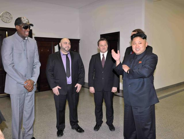 North Korean leader Kim Jong Un talks with Dennis Rodman after they watched a basketball game between former U.S. NBA basketball players and North Korean players of the Hwaebul team of the DPRK at Pyongyang Indoor Stadium