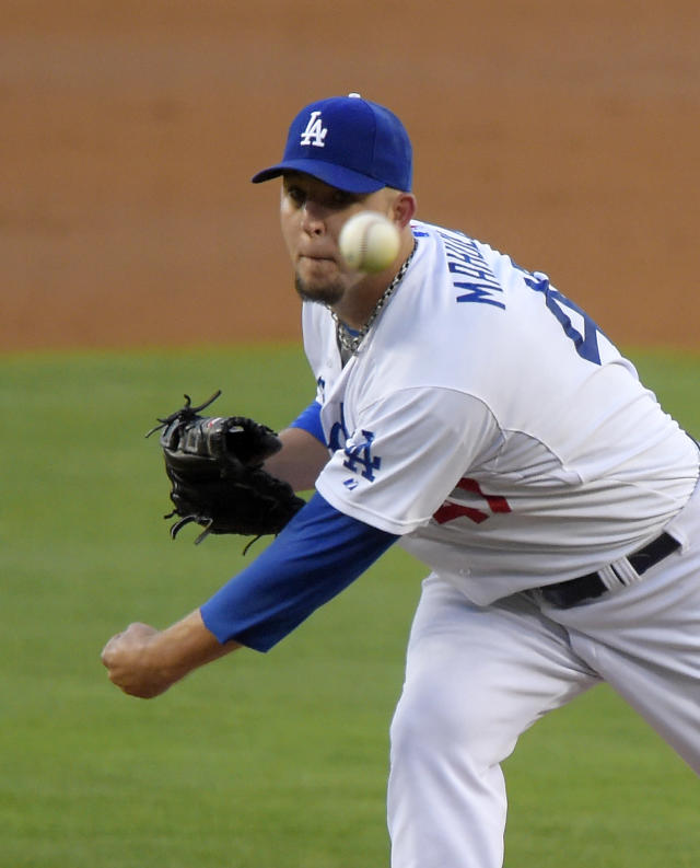 Los Angeles Dodgers relief pitcher Paul Maholm throws to the plate during the second inning of a baseball game against the San Diego Padres, Saturday, July 12, 2014, in Los Angeles. (AP Photo/Mark J. Terrill)