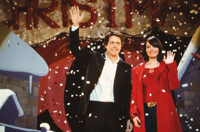"""'Love Actually' – If you hear Mariah Carey's disturbingly catchy """"All I Want For Christmas"""" at all over the holidays, director Richard Curtis' all-star crowd pleaser """"Love Actually"""" is probably the reason. Starring a who's who of U.K. acting talent( including Hugh Grant, Liam Neeson, Alan Rickman, Emma Thompson, Colin Firth, Keira Knightley, Martin Freeman, and more), """"Love Actually"""" is a series of ten interconnected stories about holiday romance in the month leading up to Christmas. Funny, charming, and altogether heartwarming, even the Grinch-iest of Grinches will have a hard time not loving """"Love Actually."""""""