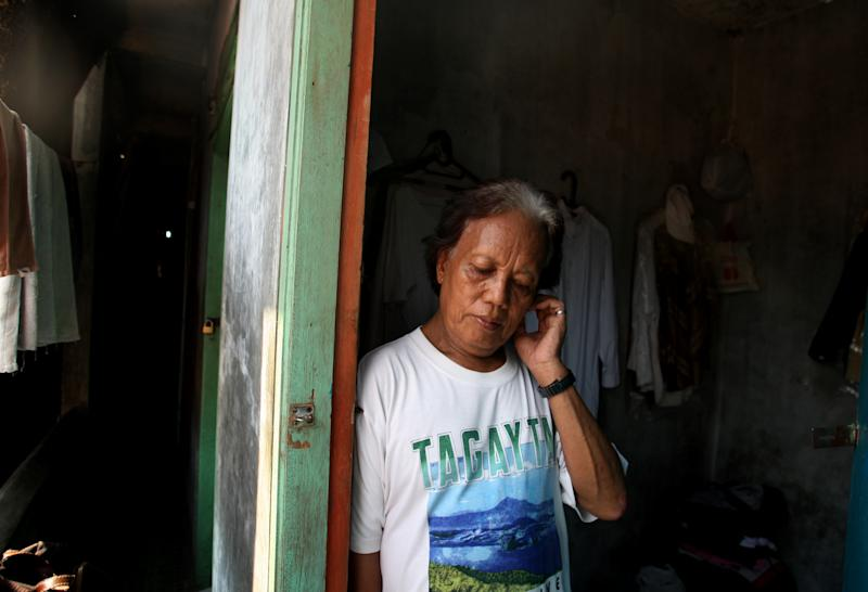In this Friday, Jan. 27, 2012 photo, Evie, also known as Turdi, the former nanny of U.S. President Barack Obama, stands at the doorway of her room at a boarding house in a slum in Jakarta, Indonesia. Evie, who was born a man but believes she is really a woman, has endured a lifetime of taunts and beatings because of her identity. Nobody knows how many transgenders live in the sprawling archipelagic nation of 240 million, but activists estimate 7 million. However, societal disdain still runs deep - when transgenders act in TV comedies, they are invariably the brunt of the joke. (AP Photo/Dita Alangkara)