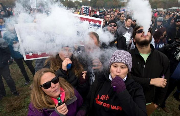 Demonstrators vape during a consumer advocate groups and vape storeowners rally in November 2019 outside of the White House to protest the proposed vaping flavor ban in Washington, DC (AFP Photo/Jose Luis Magana)