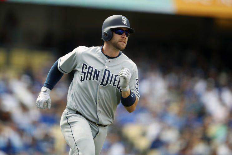 San Diego Padres second baseman Ryan Schimpf watches the ball after hitting a home run during the seventh inning of a baseball game against the Los Angeles Dodgers, Monday, April 3, 2017, in Los Angeles. (AP Photo/Ryan Kang)